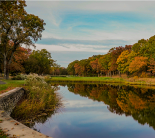 Longshore Golf Course waterway with fall colors reflected in water